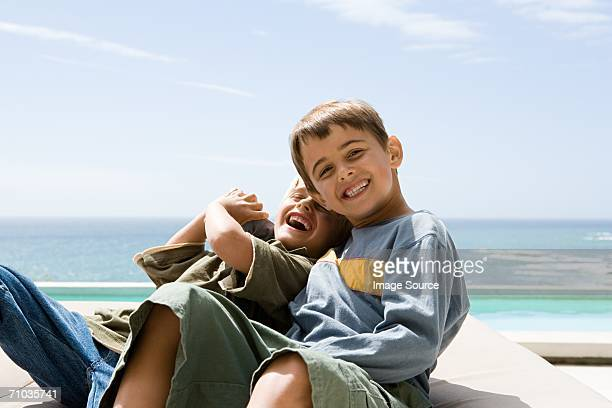 Two brothers tickling each other