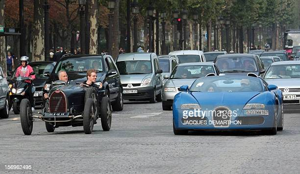 Two Bugatti cars a type 35 and a Veyron drive on the ChampsElysees Avenue on September 20 2009 in Paris at the end of a Bugatti rallye which started...