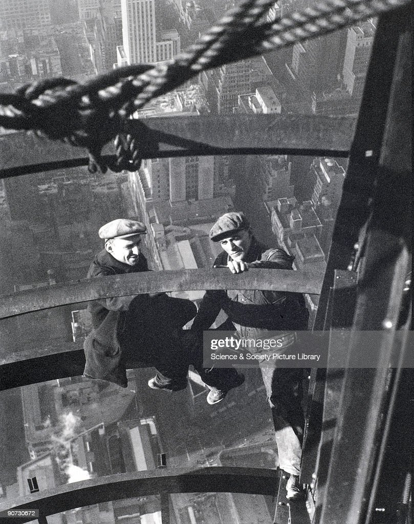 Two builders resting during the construction of the Empire State Building, New York. Photograph by Lewis Wickes Hine (1874-1940). Hine was the official photographer of the Empire State Building, and his many images celebrate the enormity of the enterprise. Hine used his photography as a documentary tool to inspire social reform. He photographed New York for about thirty years, concentrating on three separate but related areas: the European immigrants arriving at Ellis Island, the Lower East side and the Empire State Building.