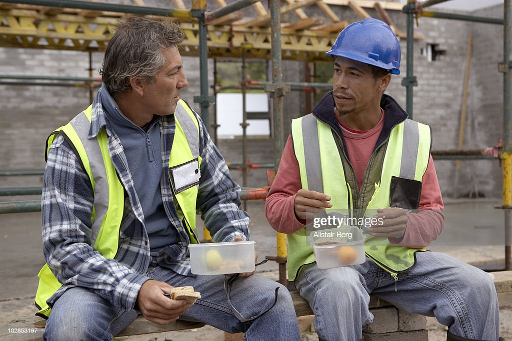 Two builders talking at lunchtime