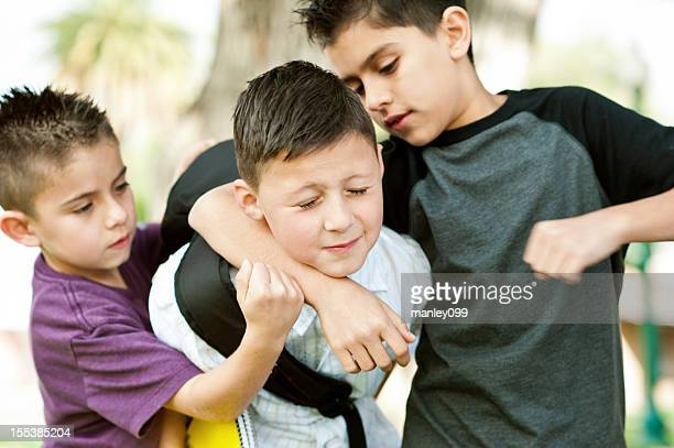 two bullies put kid in headlock