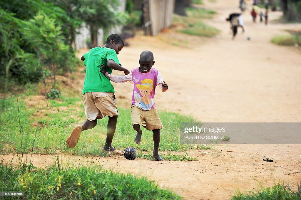 AUSSEILL --Two Burundi children play with a soccer ball made out of rolled-up plastic bags at a 'Peace Village' near the south western Burundian town of Mutambara on May 13, 2010. Some 300 resident families who live in Peace Village are part of a larger group of some 500,000 Burundian refugees who have come back to Burundi since 2002 after having fled to neighboring countries running away form a bloody 13-year civil war.