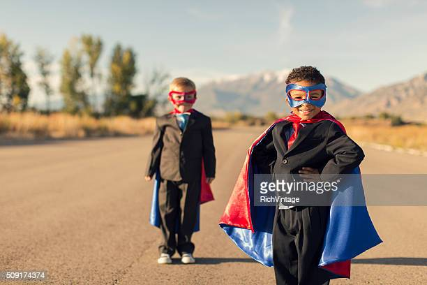 Two Business Boys Dressed in Superhero Costumes