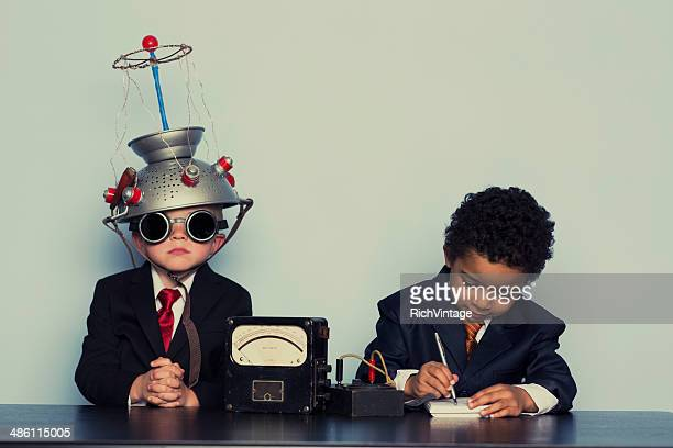 Two Business Boys Maximize Ideas with Mind Helmet