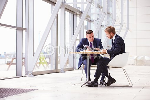 Two business colleagues at meeting in modern office interior
