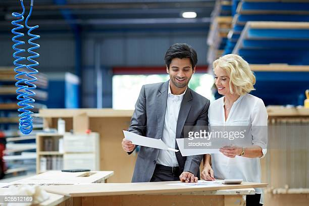 Two business colleagues discussing paperwork