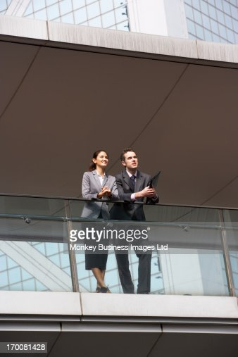 Two Business Colleagues Having Discussion Outside Office Building : Photo
