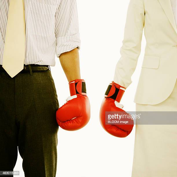 Two Business Couple Wearing Boxing Gloves