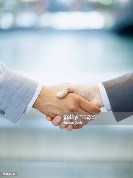 two business executives shaking hands
