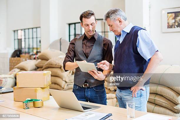 Two business men at coffee storage room