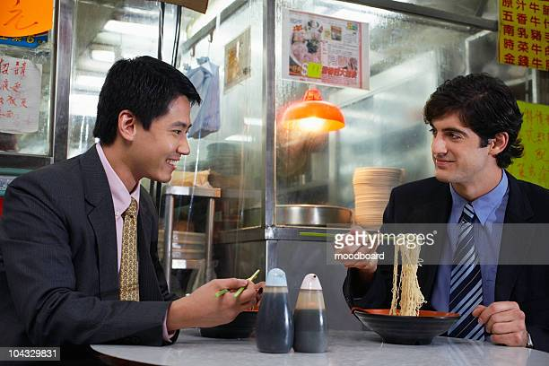Two business men having lunch in Chinese bar