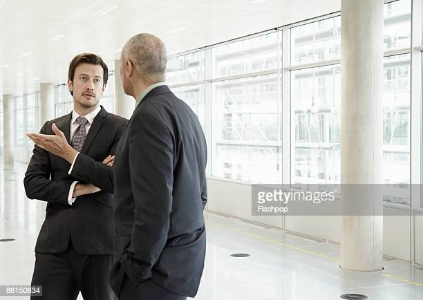 Two business men in discussion