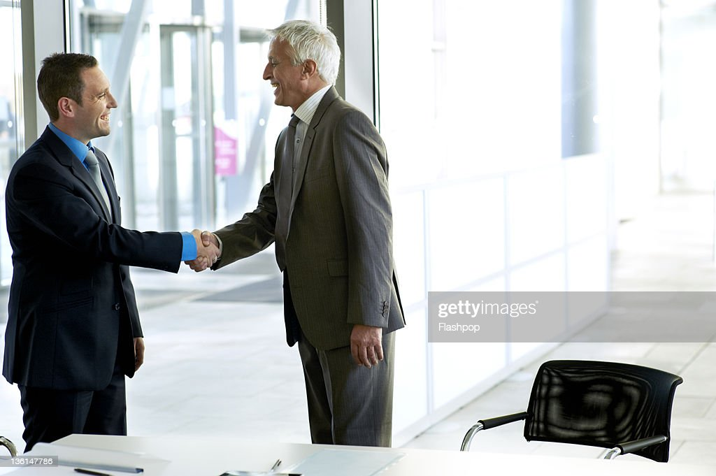 Two business men shaking hands : Stock Photo