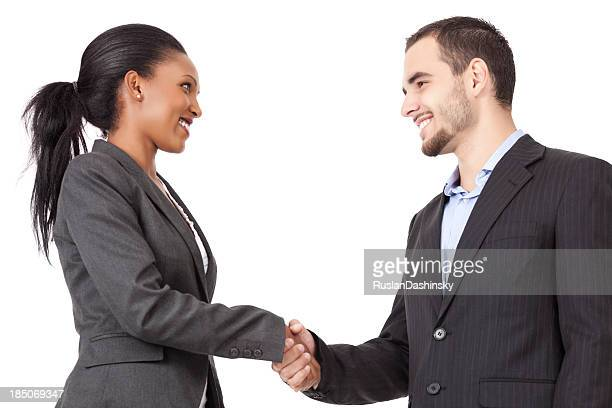 Two business partners handshaking after closing a deal