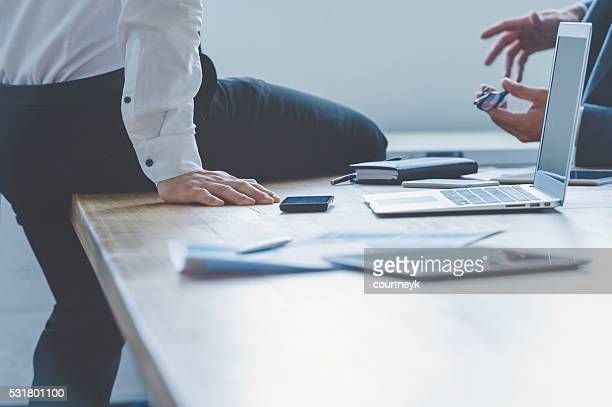 Two business people having a discussion.