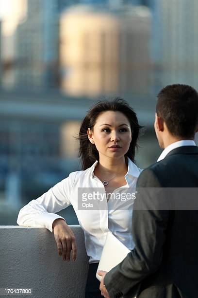 Two business people in discussion