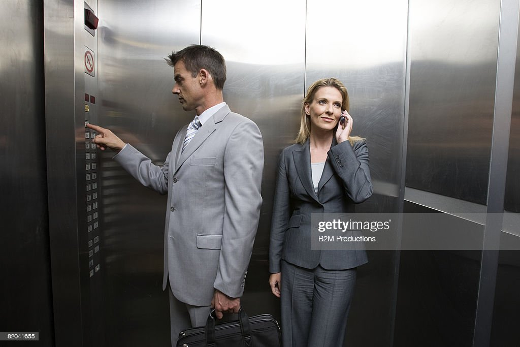 Two business people in elevator : Stock Photo