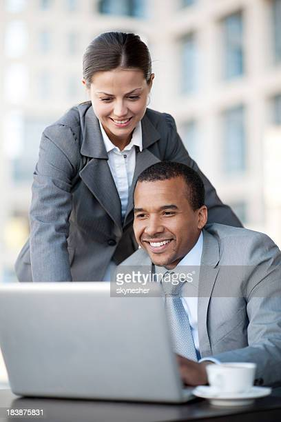Two business people looking at the laptop.