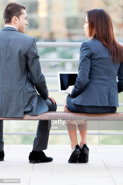 Two business people on a bench