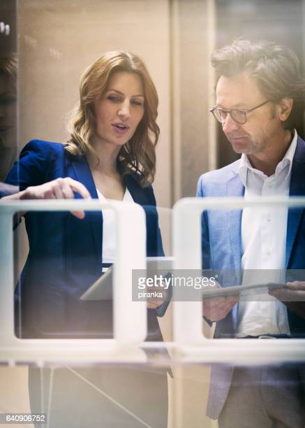Two business people talking in the in the showroom