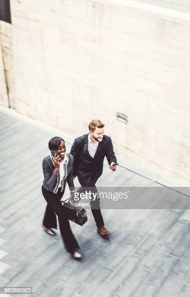 Two Business People Walking