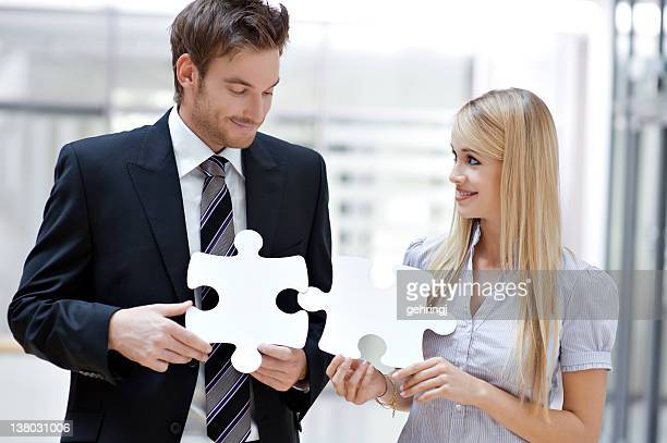 Two business people with puzzle