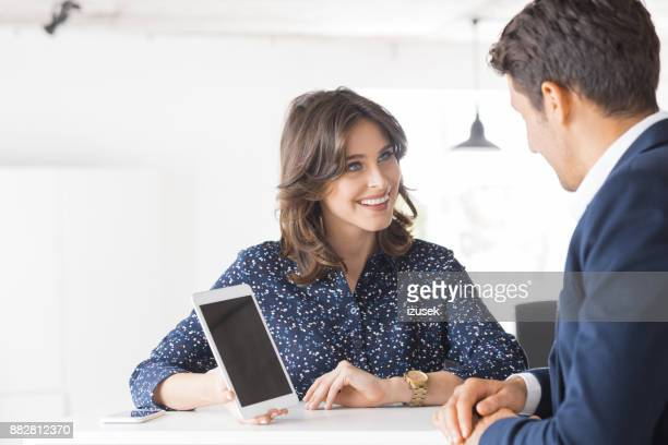 Two business people working together in office