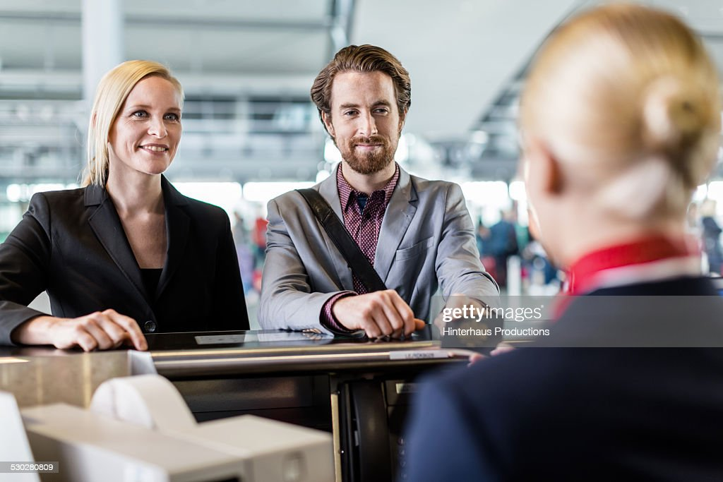 Two Business Travellers At Check-in Counter