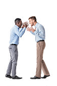 African-American businessman and a Caucasian businessman arguing on white background