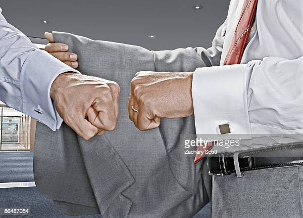 two businessman fist bump each other