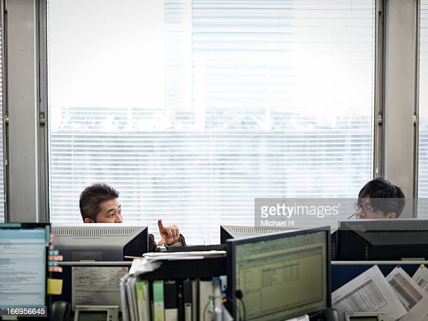 Two businessman talking in the office