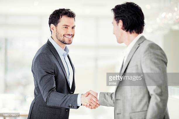 Two businessmen are shaking hands