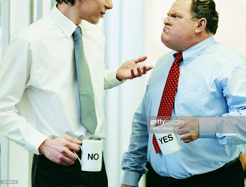 Two Businessmen Arguing With Both of Them Holding Mugs Labelled 'Yes' and 'No'