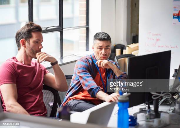 Two businessmen at the computer in start-up office