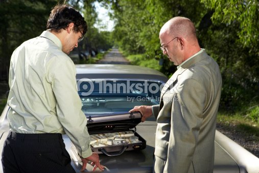 two businessmen behind car with money in briefcase rear view