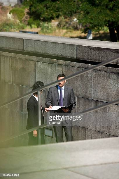 Two businessmen conducting suspicious business