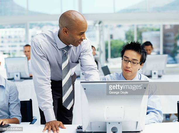 two businessmen discussing in an office