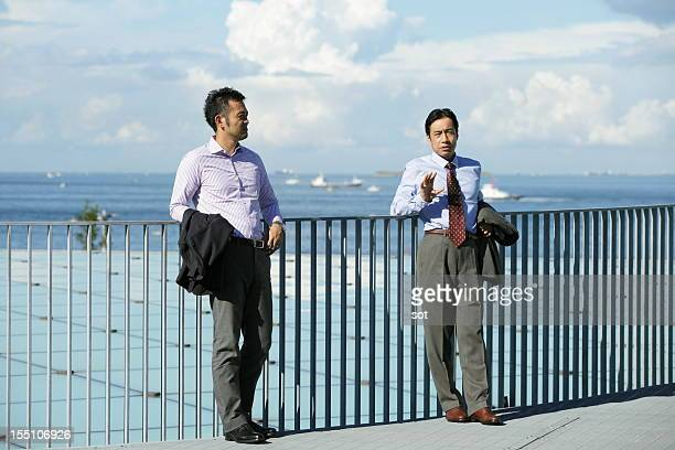 Two businessmen discussing in rooftop
