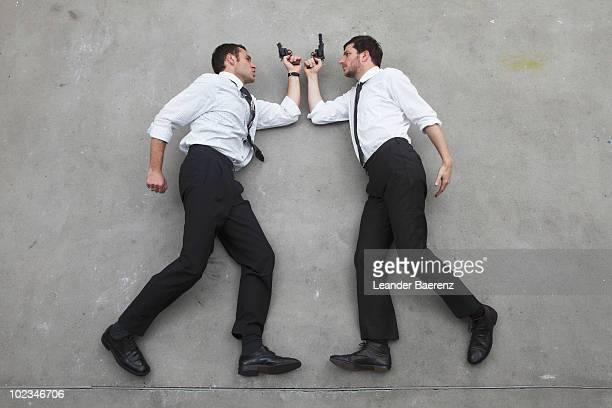 Two businessmen holding guns