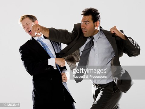 Two Businessmen Fighting Stock Photo | Getty Images