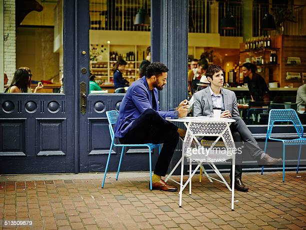 Two businessmen having a meeting at outdoor cafe
