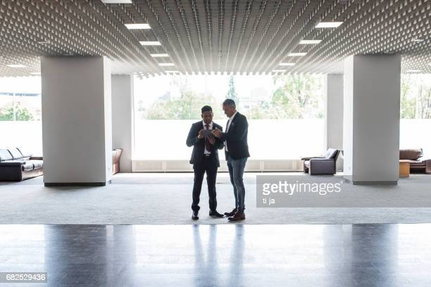 Two businessmen in a lobby