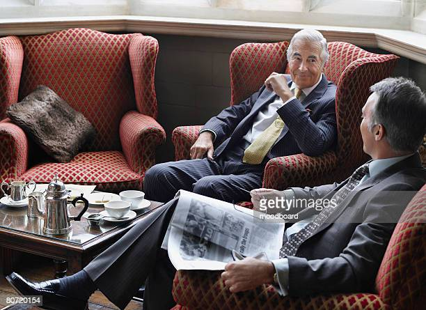 Two Businessmen in Armchairs