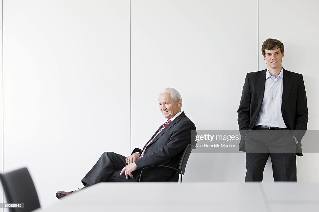 two businessmen in meeting room
