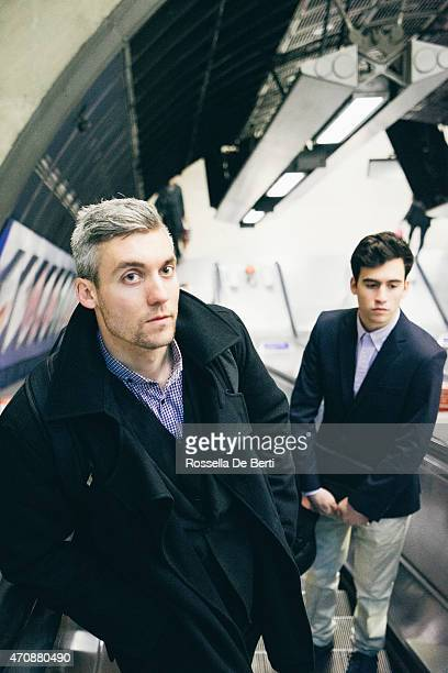 Two Businessmen In The Subway Station On Escalator