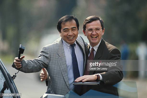 Two businessmen laughing, portrait