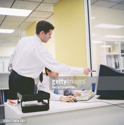 Two businessmen looking at computer screen : Stock Photo