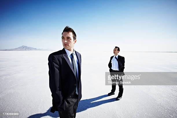 Two businessmen looking out over salt flats