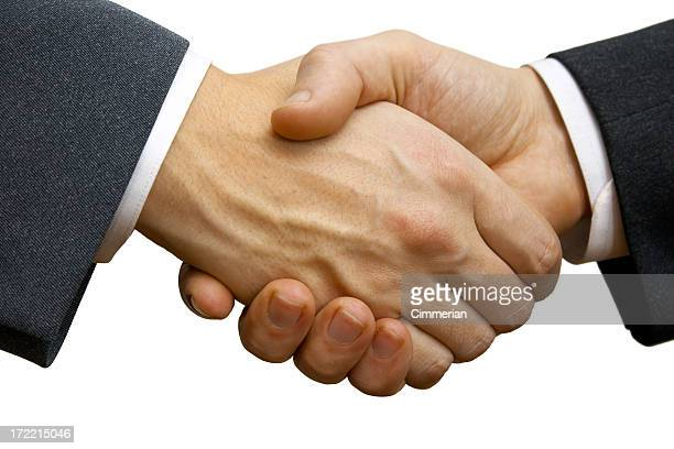 Two businessmen making deal and shaking hands in agreement