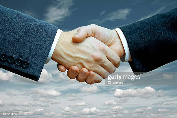 Two businessmen shaking hands after making a deal